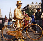 Street Entertainment  -  Golden Cycle Man with Cycle in the Royal Mile during the Edinburgh Festival  -  August 2003
