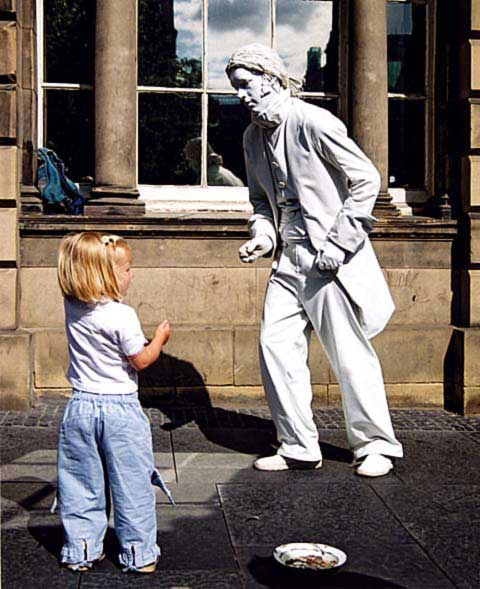 Edinburgh Festival 2003  -  White Mime Artist and Girl in the Royal Mile