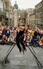 Edinburgh Festival 2003  -  Entertainer at Hunter Square  -  A Unicyclist on a Tightrope juggling three Flaming Torches
