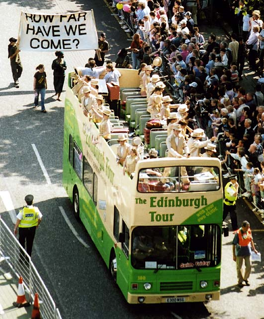 Edinburgh Festival Cavalcade 2004  -  Performers in Golden Costumes in an Open-Top Bus