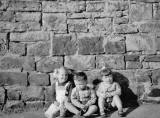 Three young children at the wall in Bedford Street, Stockbridge