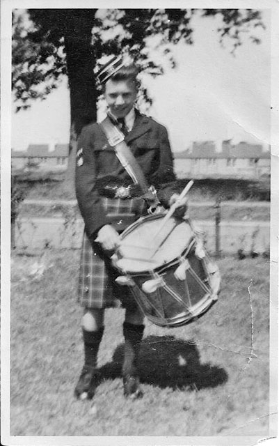 Jimmy Little, a member of Davidson's Mains Pipe Band, in his front garden at 33 Pennywell DFrive in 1950/51