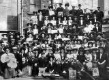 Ninety-one employees of JP Cochrane, golf club manufacturers outside their premises at Murano Street, Pilrig