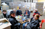 Seven of the workers, packing goods for refugees in Syria take a short lunch brea at the Edinburgh Direct Aid warehouse, 16a West Harbour Road, Granton