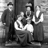 The first family at Kirkgate, Liberton on the doorstep of their house, around 1900