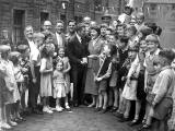 Boxer, Jackie Brown is welcomed home to Lyne Street with his Empire Games Gold Medal, July 1958