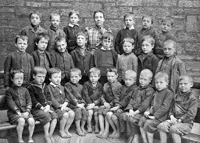 A group of barefoot children at Milton Street School, around 1895