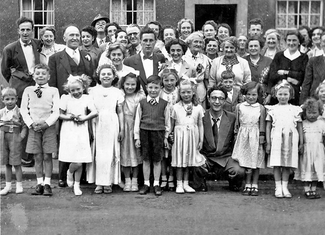 A group of neighbours and family in niddrie mains terrace for The terrace group