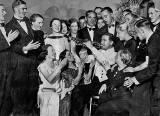A Trumpeter from Tom Bollen's Band (possibly Tom Bollen) at the Palais de Danse, surrounded by a group of 20 Dancers, 1935
