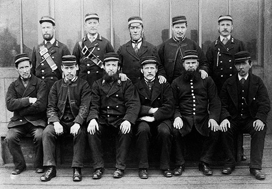 A group of Railway Workers  -  Where and when might this photo have been taken?