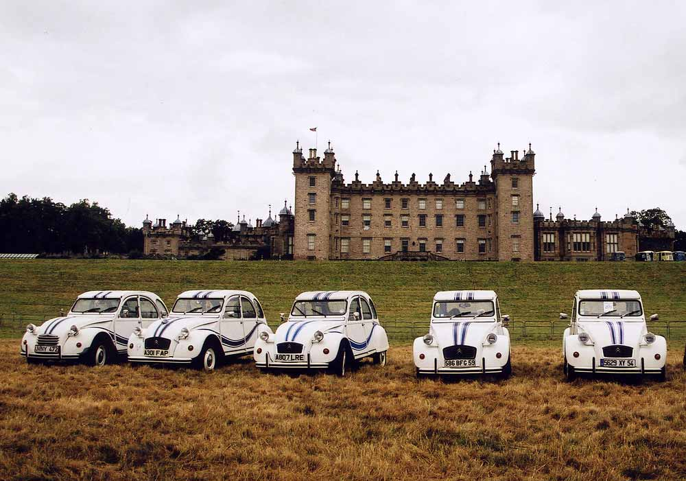 Citroen 2CV cars  in the grounds of Floors Castle,  Kelso, in the Scottish Borders  -  during the World 2CV Meeting held at Kelso, July 2005   -  Large photo
