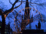 Big Wheel in Princes Street, with silhouettes, and Scott Monument behind  -  Christmas 2000..