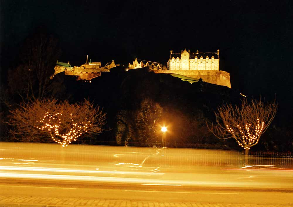 Edinburgh Castle and Christmas Lights on the trees in Princes Street Gardens