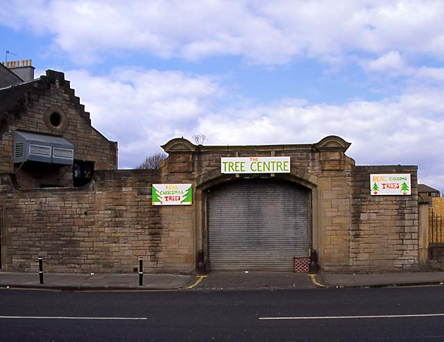 Christmas Tree Warehouse at Canonmills  -  March 1996, with the signs still on display from December 1995  -  Entrance still standing but building behind demolished