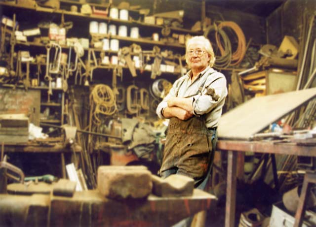 Alexander McLennan with his hammer, in the middle of his blacksmiths workshop at Powderhal