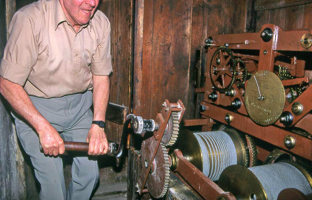 The clockwinder, winding the clock at St Andrew's & St George's Church
