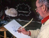 Saxe Shaw, using a quill to draw a cat