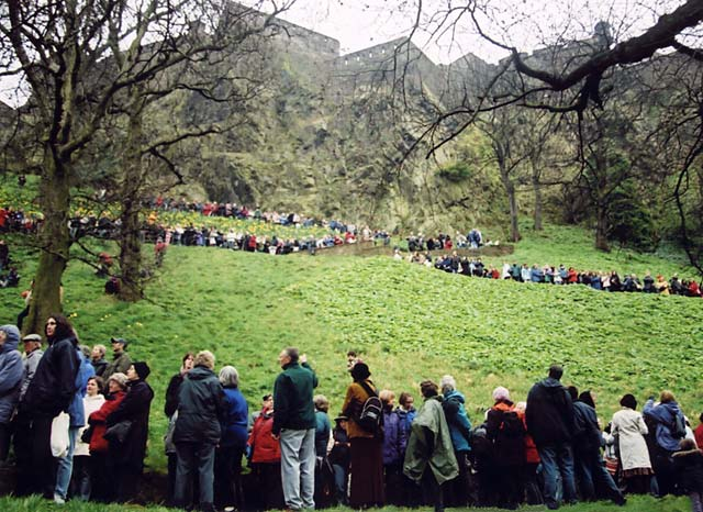 The Easter Play in West Princes Street Gardens  -  26 March 2005  -  The audience lines the paths on Caltle Rock, awaiting the Crucifixion scene.  Edinburgh Castle is in the background.