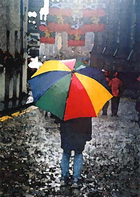 Photograph by Peter Stubbs  -  Edinburgh  -  August 2002  -  Umbrella in the Royal Mile