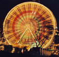 Photograph by Peter Stubbs  -  Edinburgh  -  December 2002  - The Big Wheel in Princes Street Gardens beside the Scott Monument