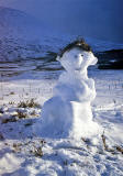 Postcard published by Johnston Financial Ltd, Edinburgh, featuring my photograph of a snowman near Rannoch Moor, Scotland