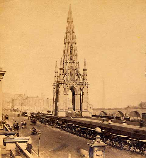Enlargement of GW Wilson stereo card - The Scott Monument and a line of coaches in Princes Street
