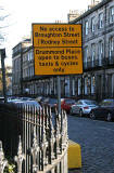 Road sign introduced into Edinburgh New Town in 2005 as part of the Central Edinburgh Traffic Management Scheme  -  Looking east along Fettes Row from Dundas Street