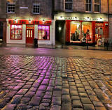 Looking from the foot of West Bow across the cobbles to the shops on the south side of the Grassmarket
