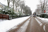 Looking west along Greenbank Drive, as a bus approaches, near the start of its journey to Trinity -  December 2009