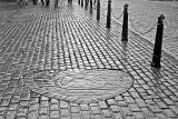 The Heart of Midlothian , set in the cobbles near the NW corner of St Giles Church in High Street, Edinburgh