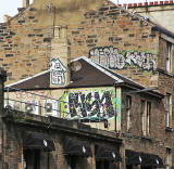 Grafffiti high on the walls on the west side of Home Street Tollcross - September 2013