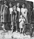 Six girls and a dog near the Howe Street end of Jamaica Street, around 1952