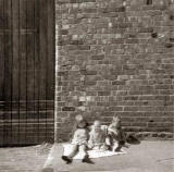 Fiona Logan, cousin Paul and brother Malcolm, outside Cummings (box makers) around 1966