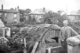 Grandfather Williamson standing outside an Anderson Shelter in a garden at Orchard Road, Edinburhgh