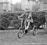 Douglas Roberts on his Tricycle in his Garden at Pilton Avenue  -  Around 1956