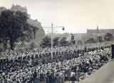 Photograph by Norward Inglis  -  Masssed Pipers march along Princes Street towards the West End during the Gathering of the Clans  -  18 August 1951