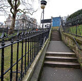 Looking up the path from Princes Street Gardens towards the Police Box near the West End of Princes Street  -   February 2010