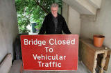David Gordon holding the traffic sign from Cramond Bridge, rescued from the River Almond