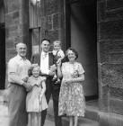 Forbes Wilson with his cousin, Lorraine, his father and his grandparents outside No 28 Thorntree Street, Leith  -  1960