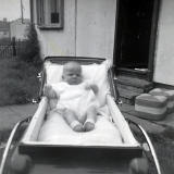 Francis in her pram outside her prefab at 8 West Pilton Terrace.  THe photo was taken in 1964.  The prefab was semolished in 1968.