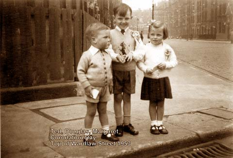 Ted, Douglas and Margaret Garry at the top of Wardlaw Street, Gorgie, on their way to a Coronation Party in 1953.